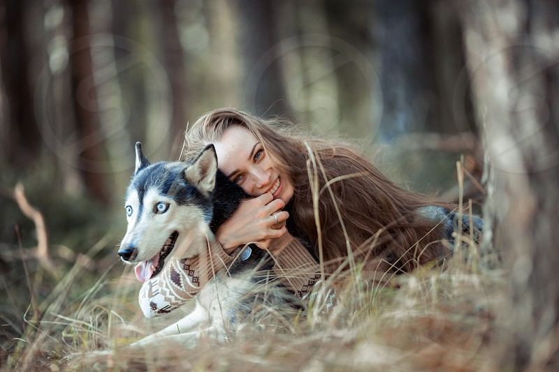 Beautiful young woman with husky dog outdoor portrait photo