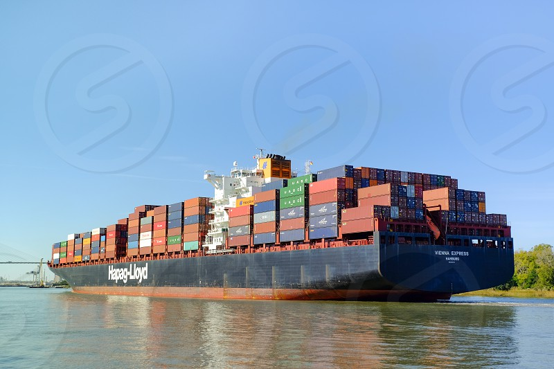 Huge container ship Hapag-Lloyd near the port in Savannah GA USA photo