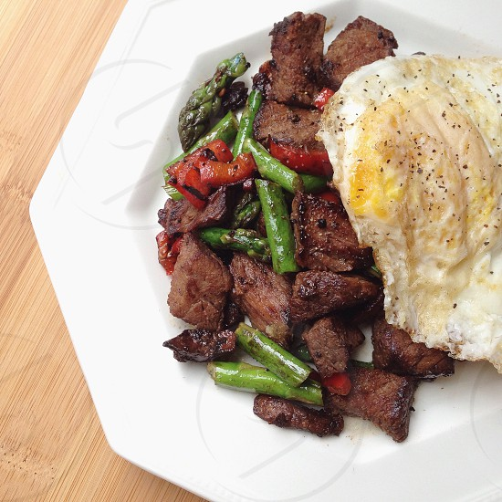Steak Stir-fry topped with a Fried Egg photo