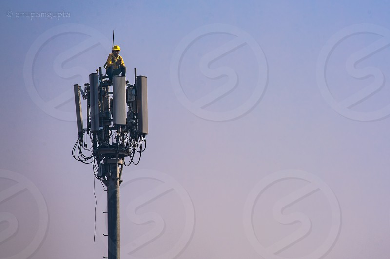 mobile tower cell phone phone tower phone reception cell phone tower top height view from top hard jobs men at work signal no signal photo