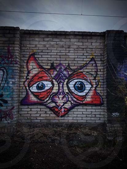 Outdoor day vertical colour colourful street art graffiti urban art face cartoon cat animal Tallinn Estonia capital city travel tourism tourist photo