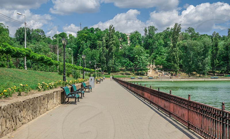 Embankment of Valea Morilor Lake in Chisinau Moldova on a sunny summer day photo