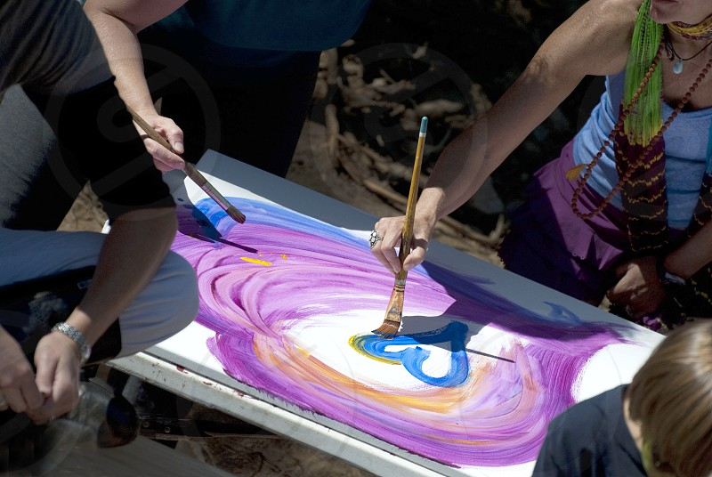 people painting on white canvas photo