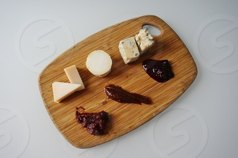 Gourmet cheese plate with jams photo