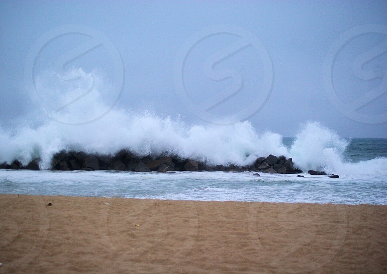 Waves crashing in the evening at a California beach photo