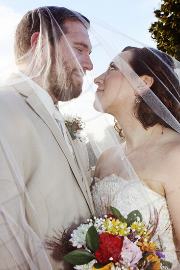 Romance is the real deal on a brisk fall night for this lovely couple on their wedding day photo
