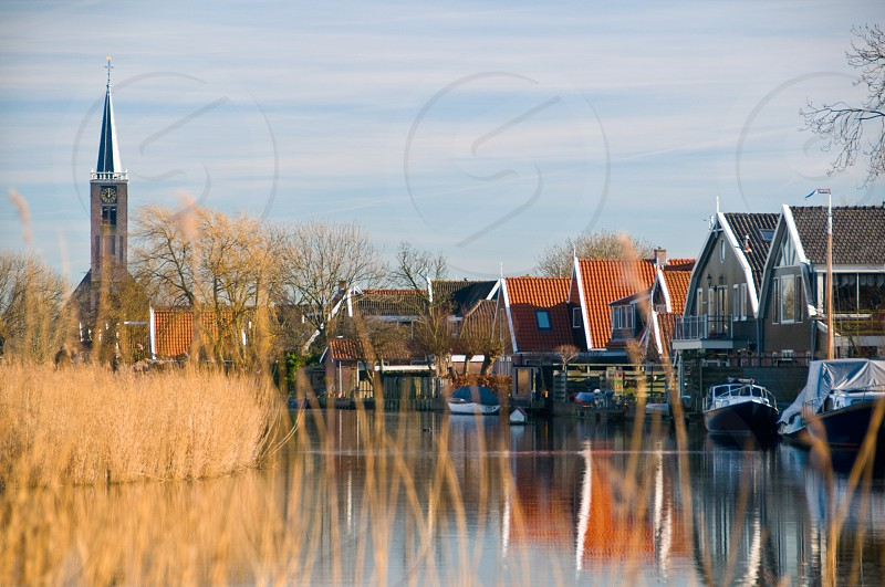 white speedboats parked in front of brown wooden houses photo