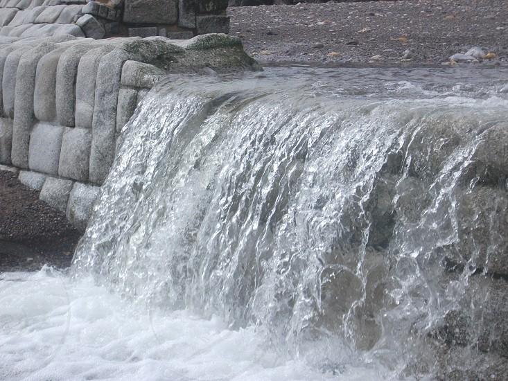 Waterfall cascading on to Dawlish beach photo