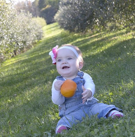Baby girl outside natural light photo