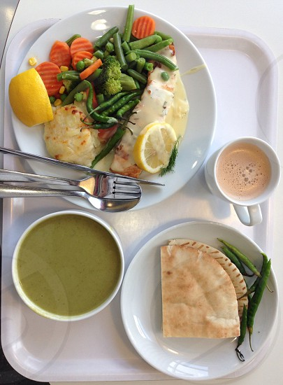 Lunch Set soup bread grilled Salmon mixed veggies baked potatoes lemon slices cardamom tea green chillies photo