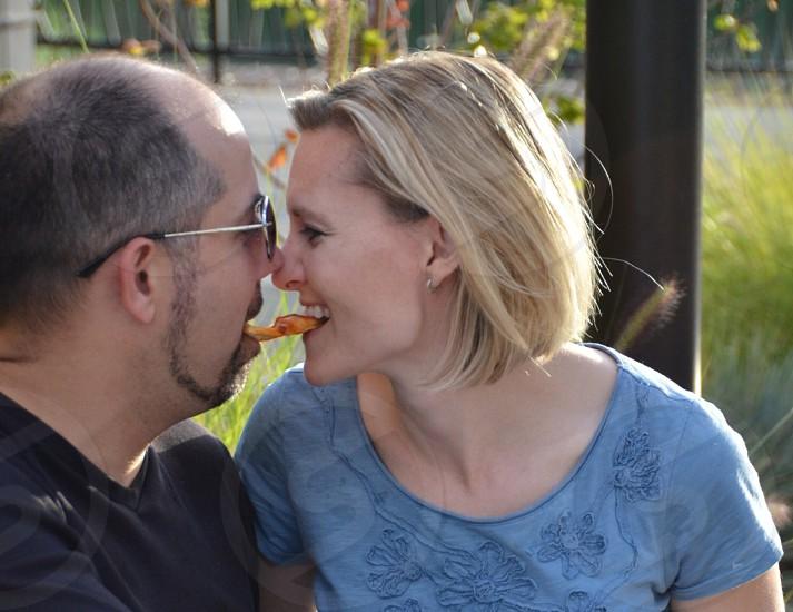 Couple sharing pizza photo