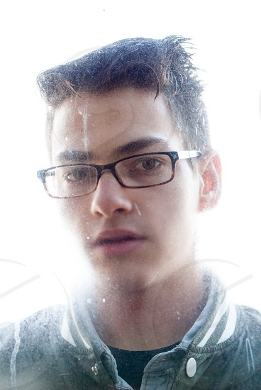 person wearing a black framed eye glasses photo