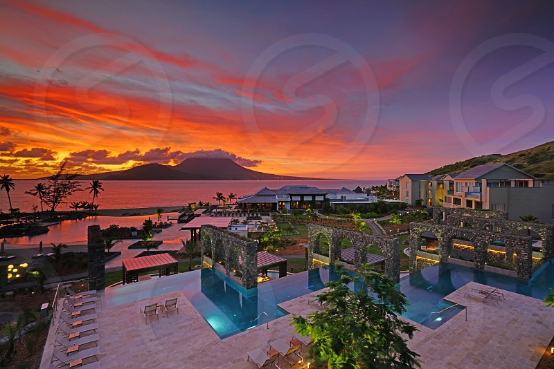 Dramatic sunrise sky over the ultra luxury Park Hyatt St Kitts resort with a view of the Nevis Peak volcano in St Kitts and Nevis photo