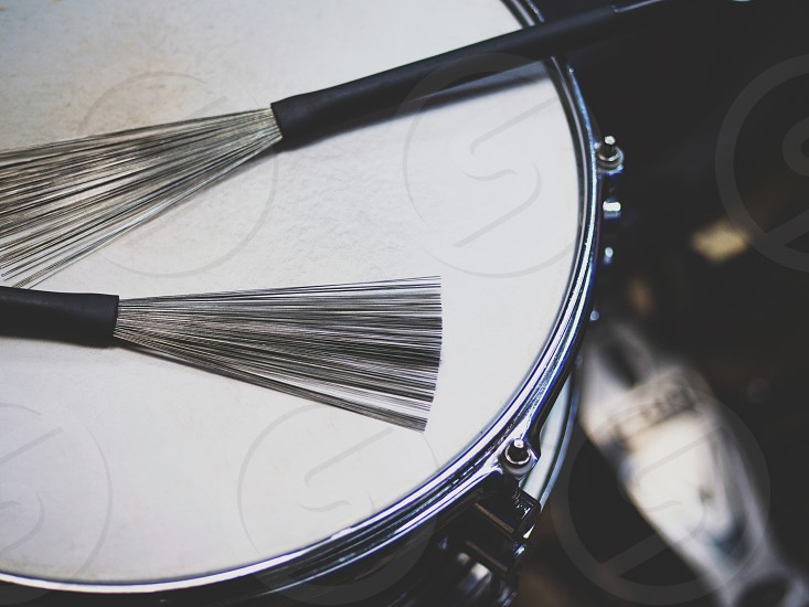 close up drum with drumsticks on black background photo