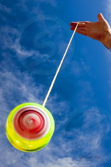 Spinning Yo Yo against Blue Sky photo