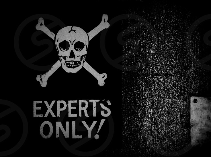 Experts Only! poster in grayscale photograph photo