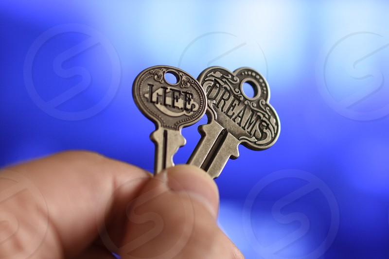 gray life key on left and gray dreams key on right photo