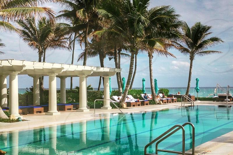 The breakers hotel florida poolside beach tropical. photo