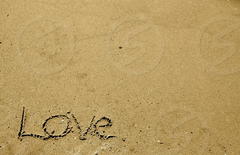 Love written in the sand photo