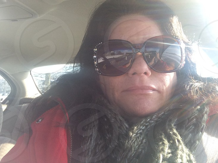 women's brown knitted scarf and red zip-up jacket photo