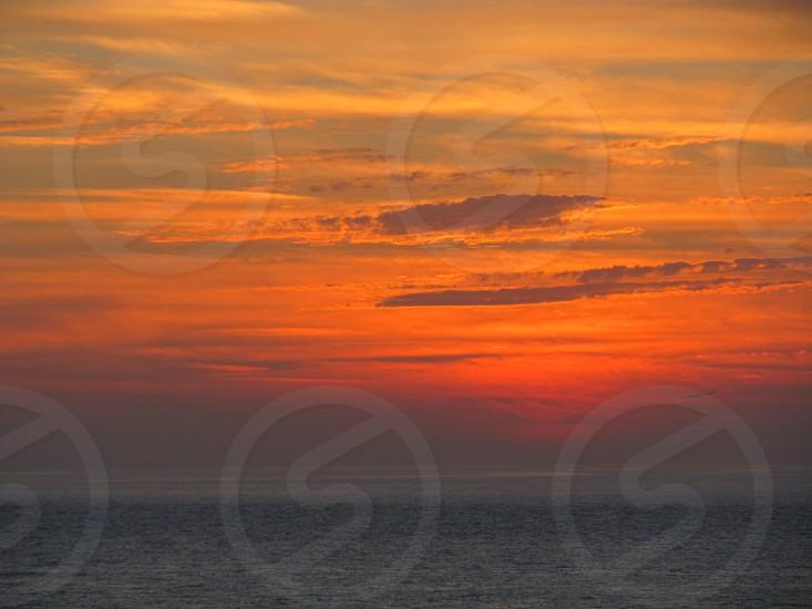 Orange sunset over ocean photo