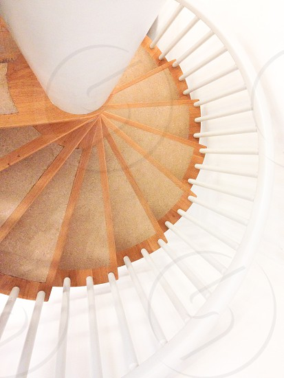 brown wooden spiral staircase photo