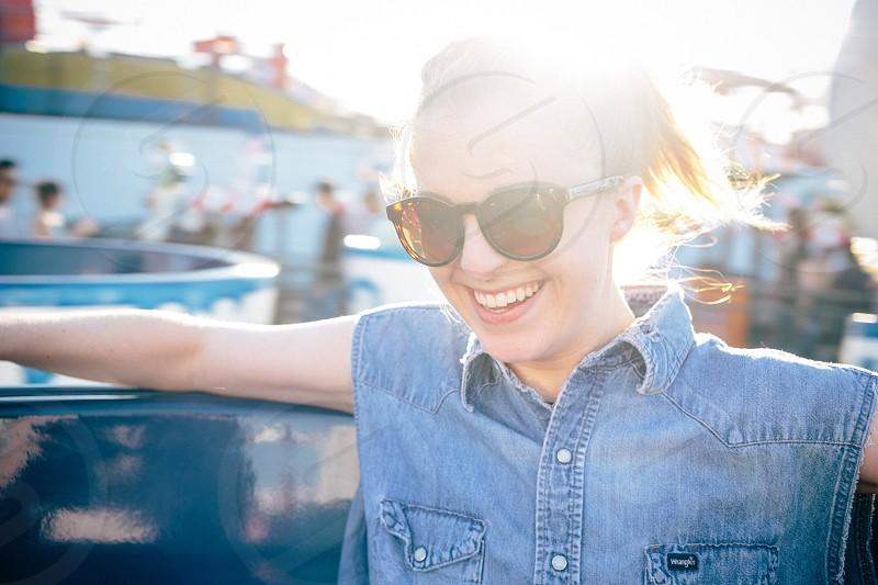 woman in blue denim button up vest photo