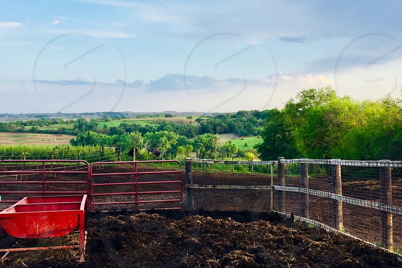 View from a barnyard overlooking a lush country landscape photo