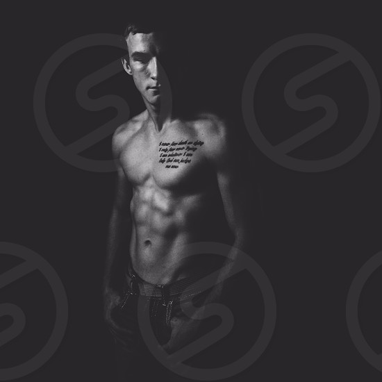 Black and white shirtless man. photo
