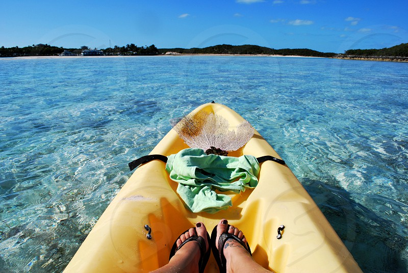 kayaking in the beautiful crystal blue waters of Sampson Cay in The Exumas Bahamas photo