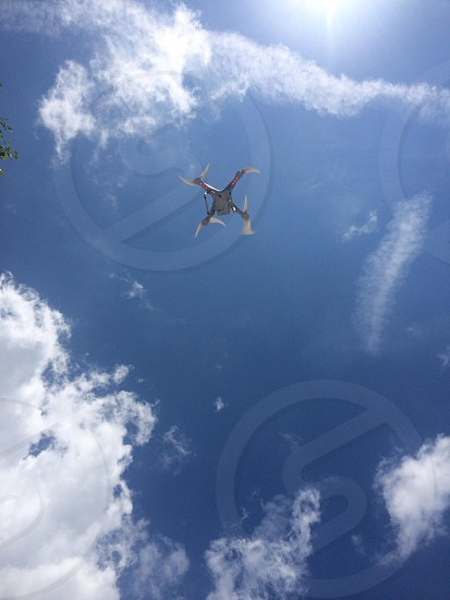 A remote control drone above us through the sunroof in my car!  photo