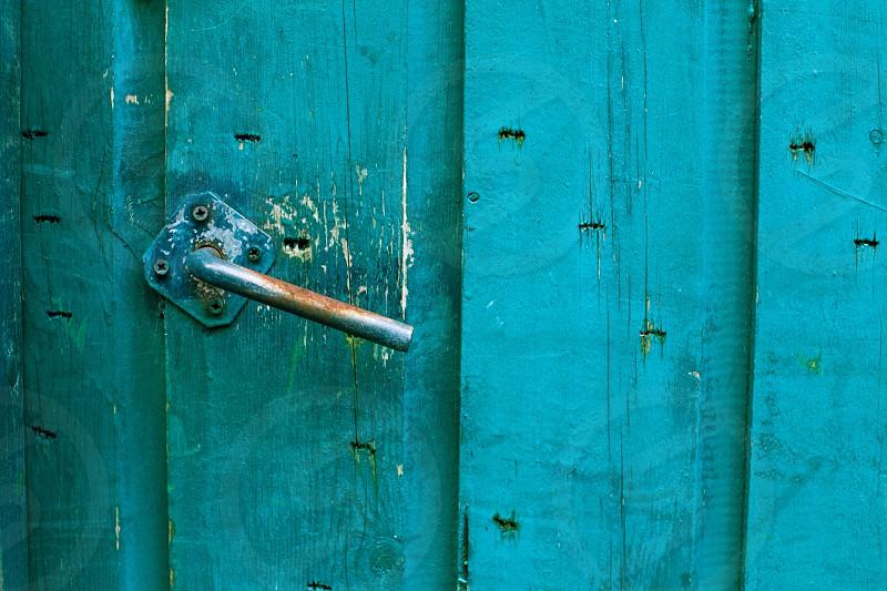 old blue door with rustay handle. taken in Haarlen the Netherlands photo