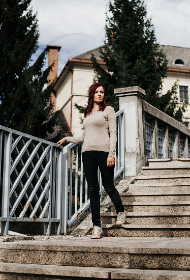 Young beautiful girl in the city walking down the stairs. photo