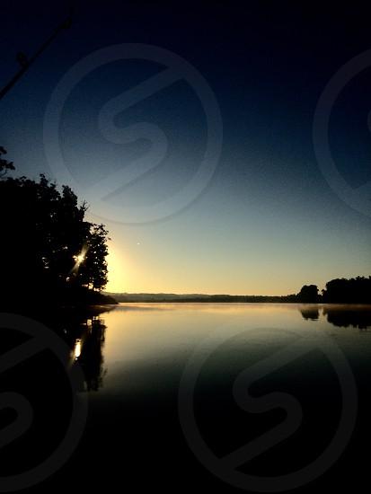 Morning sunrise on the lake photo