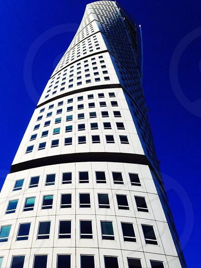 Building buildings architecture Europe pattern patterns symmetry endless windows blue sky ground view up photo