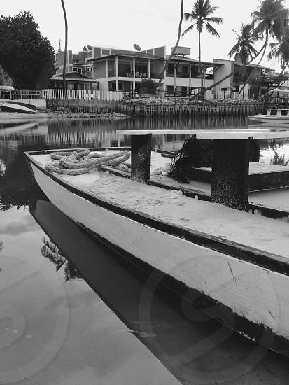 black white photo boats on inlet photo