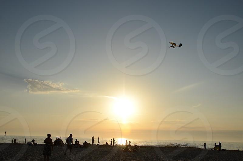 sun shining over beach photo