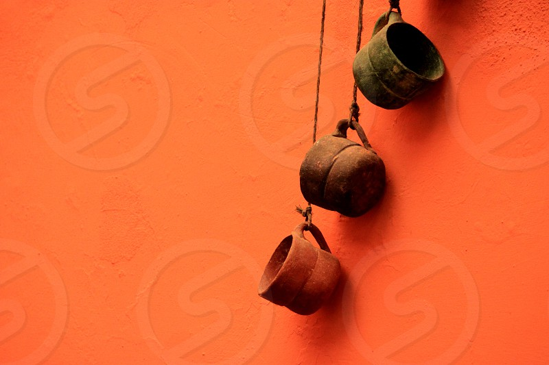 green plastic dipper hanging on orange wall photo