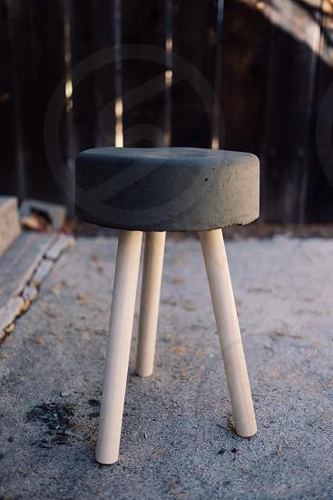 grey padded round stool photo