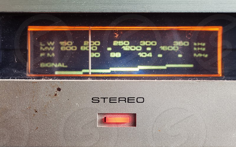 Details of an old radio receiver closeup view on button for stereo.  photo