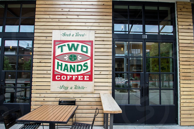 two hands coffee store photo