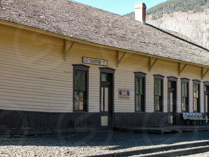 The track side of the historic Silverton Colorado railroad depot built for the Denver & Rio Grande railroad now serves the steam powered trains on the Durango and Silverton Narrow Gauge Railroad. photo