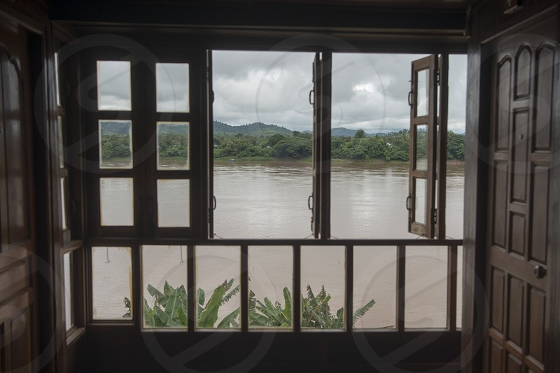 the landscape of the mekong river at the town of Chiang Khan in Isan in north east Thailand photo