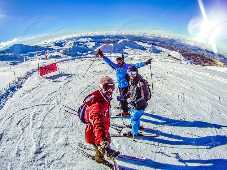 Group of friends skiing at the alps photo