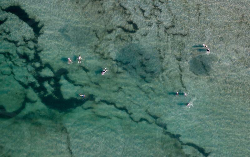 Aerial beach ocean summer swimming drone photo