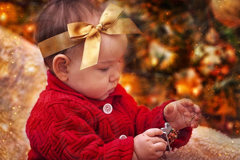 Cute girl baby toddler portrait face person people ribbon band hair hand Christmas eve gift photo