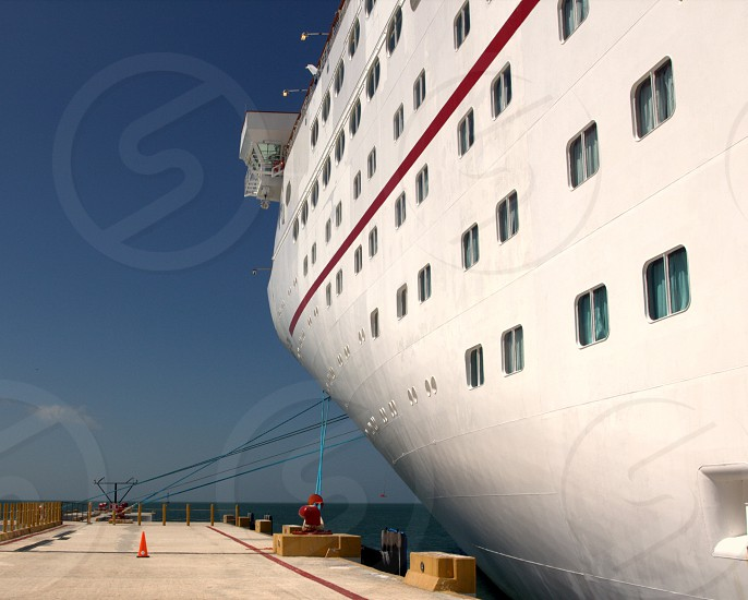 Side of cruise ship at dock photo