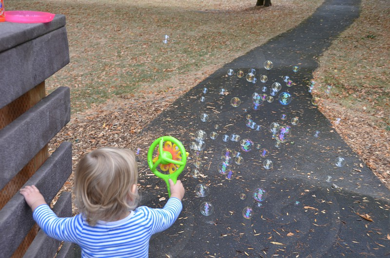 Child with bubble blower photo