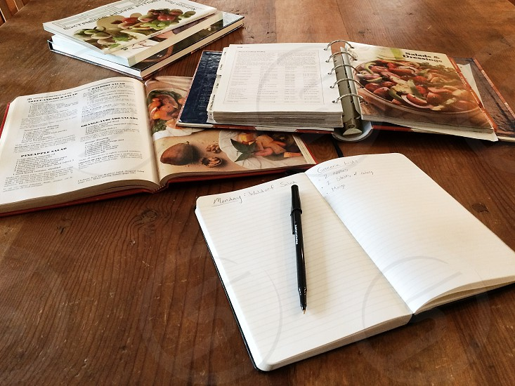 black pen and white page book in the table photo