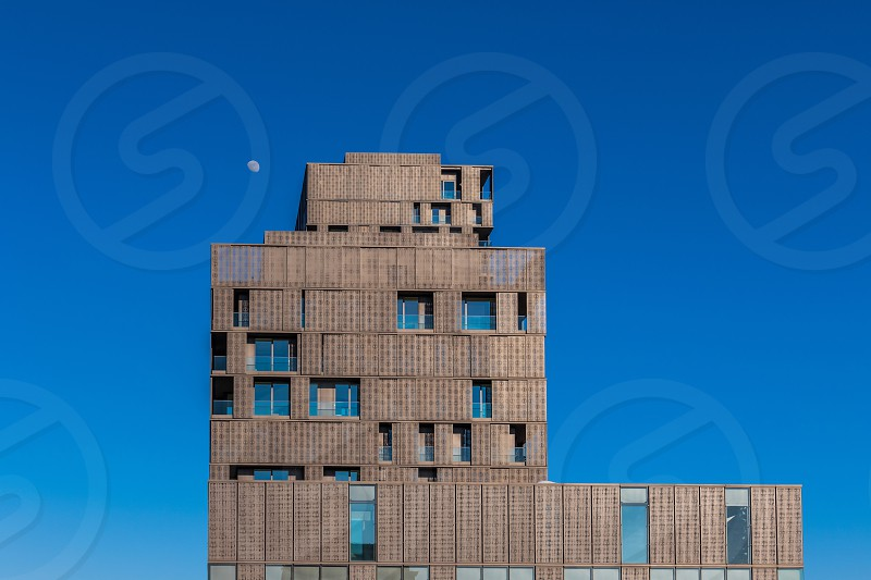 brown concrete building under blue sky photo